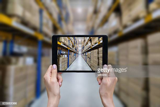 ordering on-line from modern warehouse - heavy industry stock photos and pictures