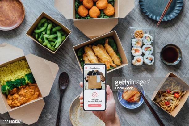 ordering takeaway meal at home - ordering stock pictures, royalty-free photos & images