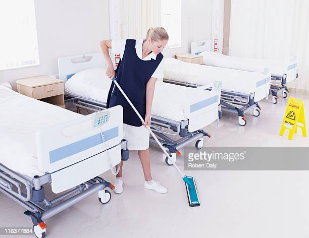 orderly mopping hospital floor - janitor stock photos and pictures