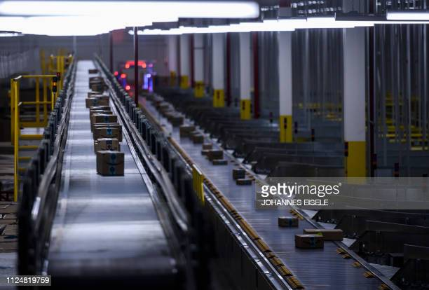 Orders move down a conveyor belt at the 855000squarefoot Amazon fulfillment center in Staten Island one of the five boroughs of New York City on...