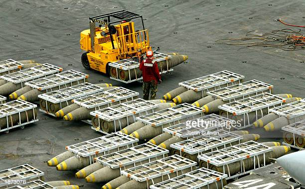 Ordnance handlers move 2000pound bomb units after they were delivered to the USS Constellation from the USNS Flint March 26 2003 in the Persian Gulf...