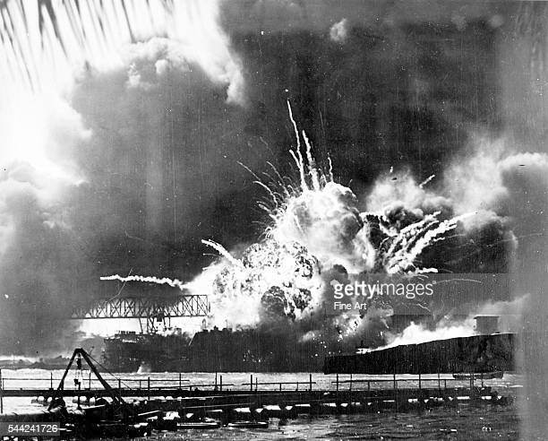 Ordnance on the destroyer USS Shaw explodes after being hit by Japanese bombs Pearl Harbor Hawaii December 7 1941 Silver print taken by a Navy...