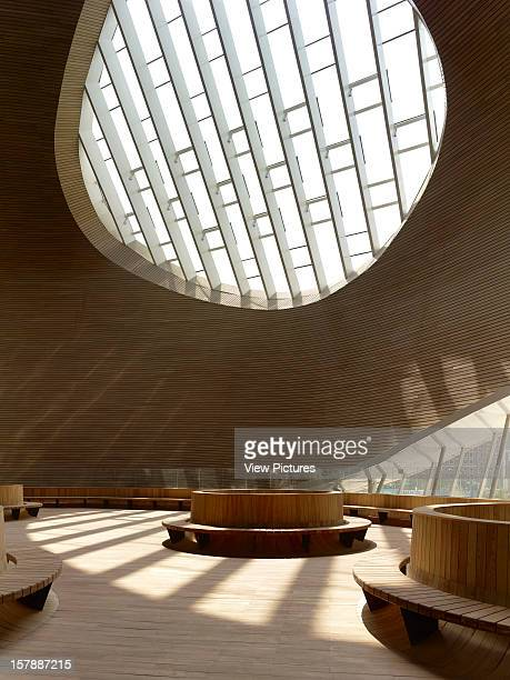 Ordos Museum Mad Architects Ordos Inner Mongolia China Hall Interior With Oval Windows And Circular Seating Benches Mad Architects China Architect