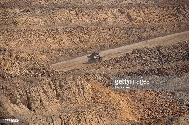 Ore is driven to a processing plant in a Caterpillar Inc mining truck after being excavated from an open pit at Katanga Mining Ltd's KOV copper and...