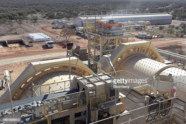Ore is fed into the sag mills foreground at Saracen Mineral Holdings Ltd's Thunderbox gold mine south of Leinster Australia on Sunday July 31 2016...