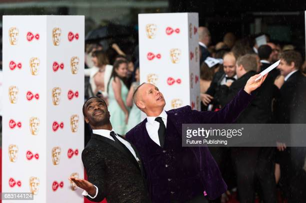 Ore Oduba and Robert Rinder attend the Virgin TV British Academy Television Awards ceremony at the Royal Festival Hall on May 14 2017 in London...