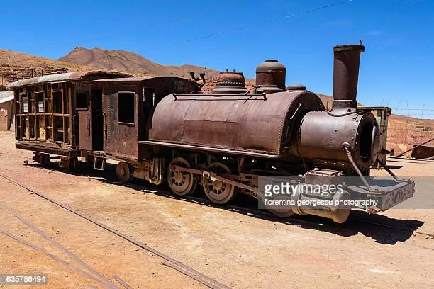 ore train car and steam locomotive, pulacayo, bolivia - bolivien stock-fotos und bilder