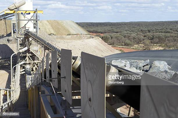 Ore travels along a conveyor belt from the crusher left to the sag mills at Saracen Mineral Holdings Ltd's Thunderbox gold mine south of Leinster...