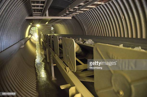 Ore travels along a conveyor belt from the crusher to the sag mills at Saracen Mineral Holdings Ltd's Thunderbox gold mine south of Leinster...
