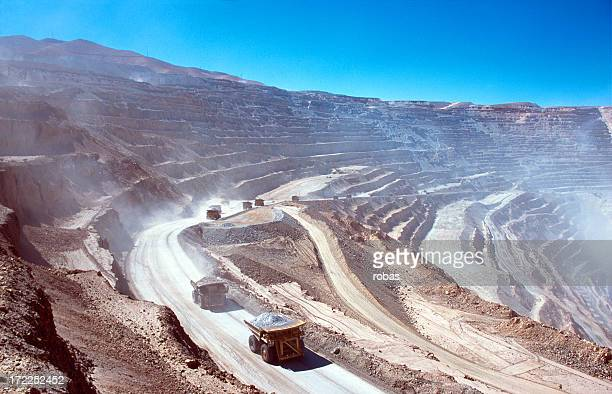 ore trucks in an open-pit mine - chile stock pictures, royalty-free photos & images