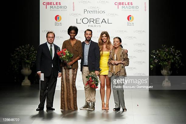 L'Oreal Director Jean Baptiste Dalle model Sessilee Lopez Spanish designer Juanjo Oliva Manuela Velasco and Cuca Solana pose for photographers during...
