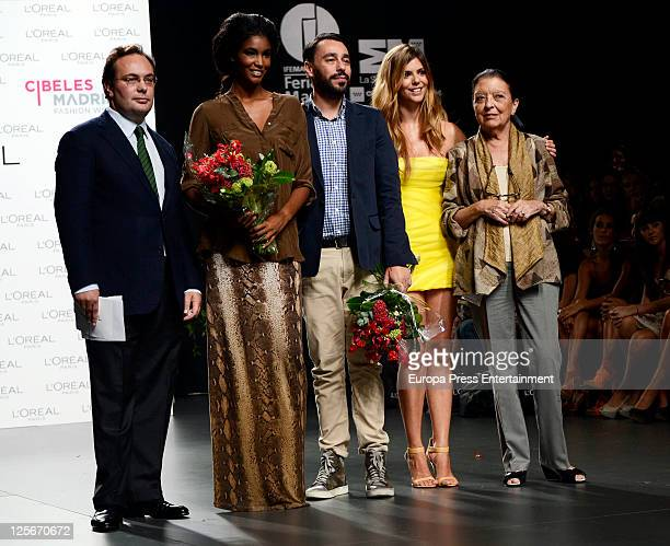 L'Oreal Director Jean Baptiste Dalle model Sessilee Lopez Spanish designer Juanjo Oliva actress Manuela Velasco and Cuca Solana pose for...