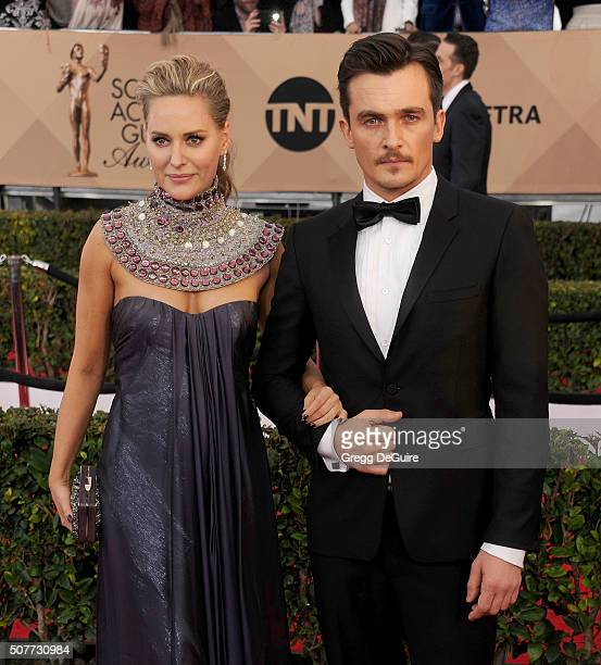 Oreal Paris Spokesperson Aimee Mullins and actor Rupert Friend arrive at the 22nd Annual Screen Actors Guild Awards at The Shrine Auditorium on...