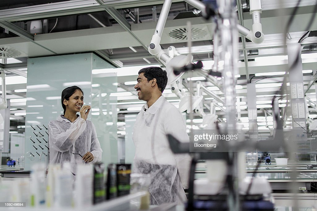 L'Oreal SA employees share a laugh at the company's first research and innovation center in Mumbai, India, on Thursday, Jan. 10, 2013. L'Oreal SA, the world's largest cosmetics maker, today inaugurated its new Indian R&I center. Photographer: Dhiraj Singh/Bloomberg via Getty Images