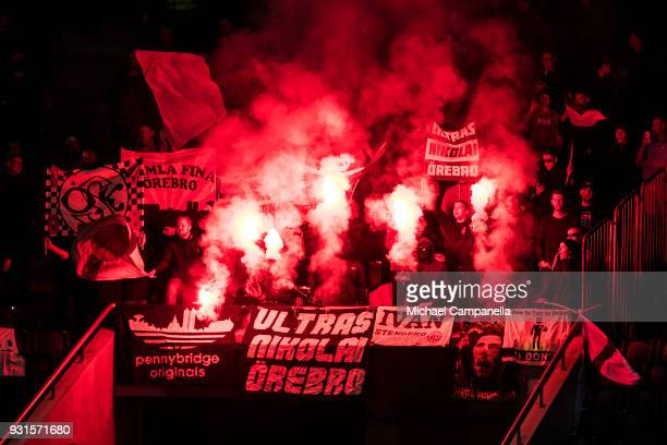 Orebro supporters light flares during a Swedish Cup quarter final match between AIK and Orebro SK at Friends arena on March 13 2018 in Solna Sweden