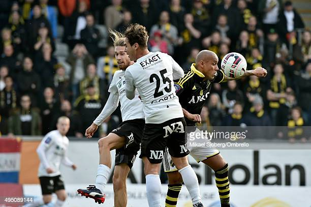 Orebros Nordin Gerzic and Daniel Nordmark fighting over the ball with AIKs Alessandro Pereira during the match between Orebro SK and AIK at Behrn...
