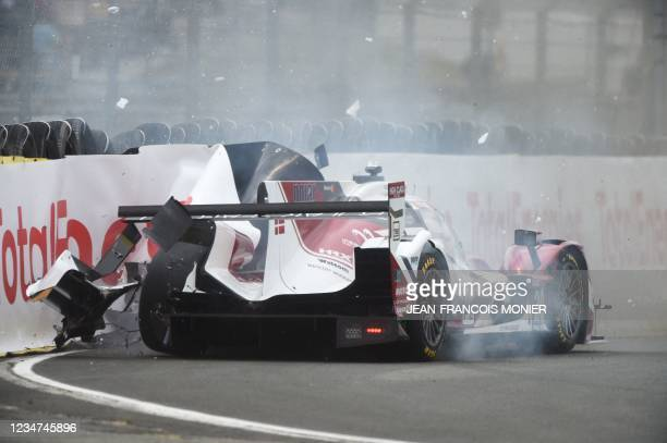 Oreca07 Gibson LMP2's Danish driver Marco Sorensen crashes in the first corner during the first practice session in Le Mans, northwestern France, on...