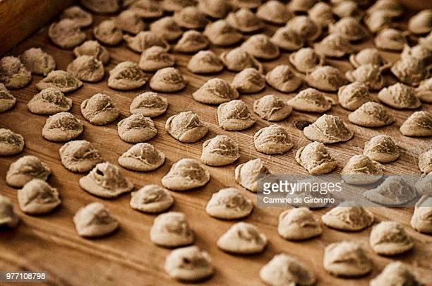 Orecchiette pasta on wooden background, Francavilla Fontana, Apulia, Italy
