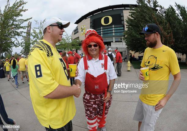 Oregon and Nebraska fans greet one another prior to the start of the game during a college football game between the Nebraska Cornhuskers and Oregon...