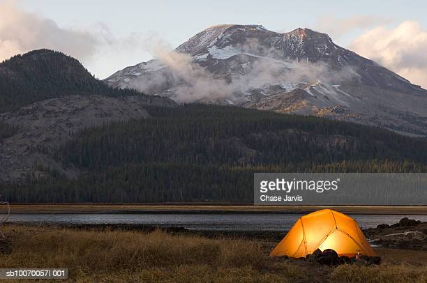 usa, oregon, bend, illuminated tent by lake in mountains - camping stock photos and pictures