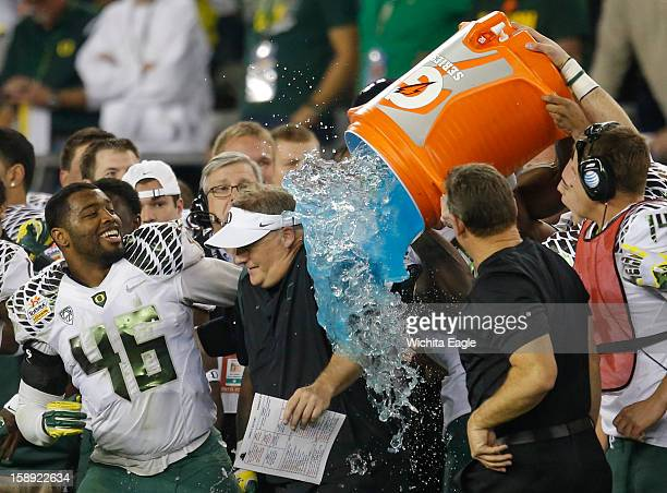Oregon coach Chip Kelly gets dunked by Gatorade after his team defeated Kansas State, 35-17, in the Tostitos Fiesta Bowl at the University of Phoenix...