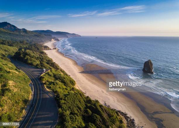 oregon coast highway passing cannon beach - aerial shot - oregon coast stock pictures, royalty-free photos & images