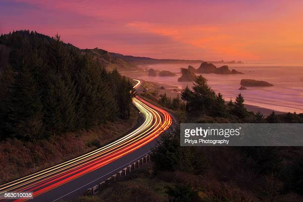 oregon coast - light trail stock photos and pictures