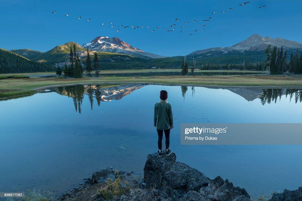 Oregon, Deschutes County, Bend, Sparks Lake, woman at lake