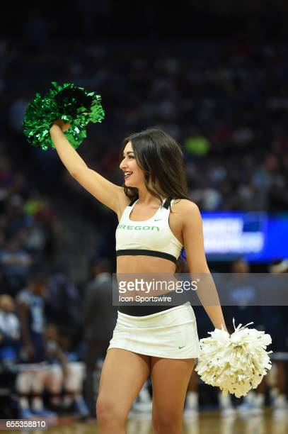 Oregon Ducks cheerleader performs before the start of the Oregon Ducks game versus the Rhode Island Rams in their NCAA Division I Men's Basketball...