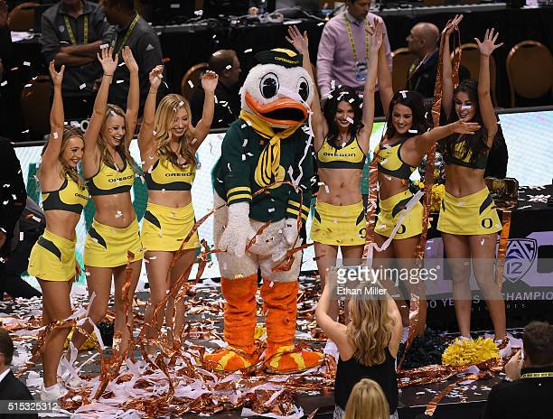 Oregon Ducks cheerleaders and mascot The Duck throw confetti as they celebrate the team's 8857 win over the Utah Utes to win the championship game of...