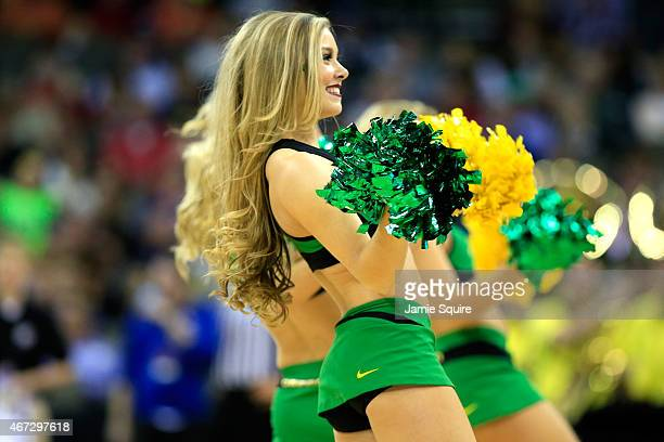 Oregon Ducks cheerleaders perform as the Oregon Ducks play the Wisconsin Badgers during the third round of the 2015 NCAA Men's Basketball Tournament...