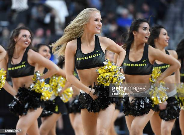 Oregon Ducks cheerleaders perform during a quarterfinal game of the Pac12 basketball tournament against the Utah Utes at TMobile Arena on March 14...