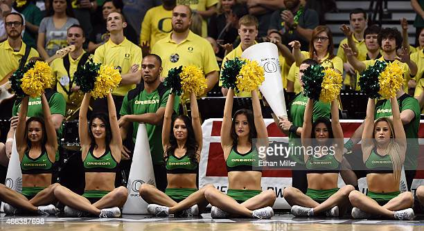 Oregon Ducks cheerleaders perform during the championship game of the Pac12 Basketball Tournament against the Arizona Wildcats at the MGM Grand...