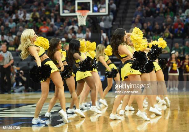 Oregon Ducks cheerleaders perform during the first half of the Oregon Ducks game versus the Iona Gaels in their NCAA Division I Men's Basketball...