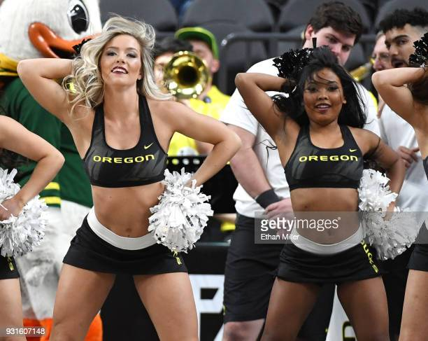 Oregon Ducks cheerleaders perform during the team's firstround game of the Pac12 basketball tournament against the Washington State Cougars at...