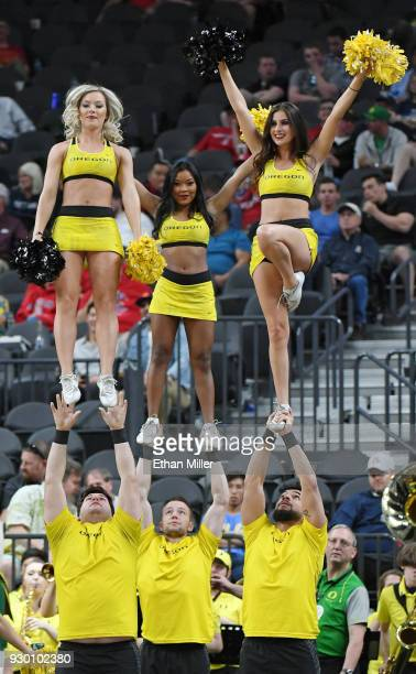 Oregon Ducks cheerleaders perform during the team's semifinal game of the Pac12 basketball tournament against the USC Trojans at TMobile Arena on...