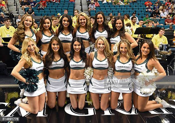 Oregon Ducks cheerleaders pose before the team's quarterfinal game of the Pac12 Basketball Tournament against the Washington Huskies at MGM Grand...