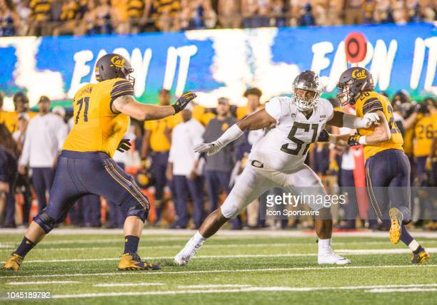 Oregon Ducks defensive lineman Gary Baker guards two California Golden Bears players during the football game between the Oregon Ducks and the...