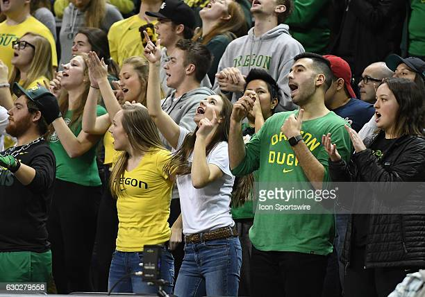 Oregon Ducks fans cheer during a nonconference NCAA basketball game between the University of Montana Grizzlies and University of Oregon Ducks on...