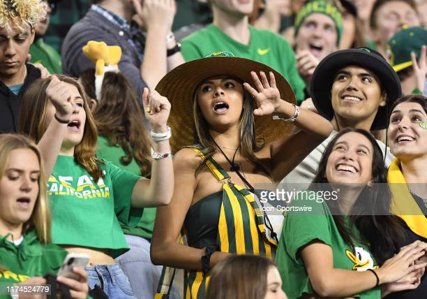 Oregon Ducks fans dance in the stands during a college football game between the Cal Bears and Oregon Ducks at Autzen Stadium in Eugene, Oregon.