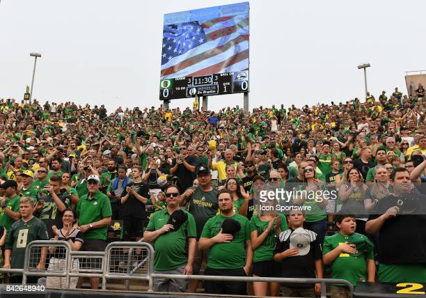 Oregon Ducks fans stand for the National Anthem during a college football game between the Southern Utah Thunderbirds and Oregon Ducks on September 2...