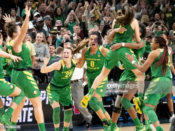Oregon Ducks guard Sabrina Ionescu reacts with her teammate Oregon Ducks forward Satou Sabally after the NCAA Division I Women's Championship Elite...