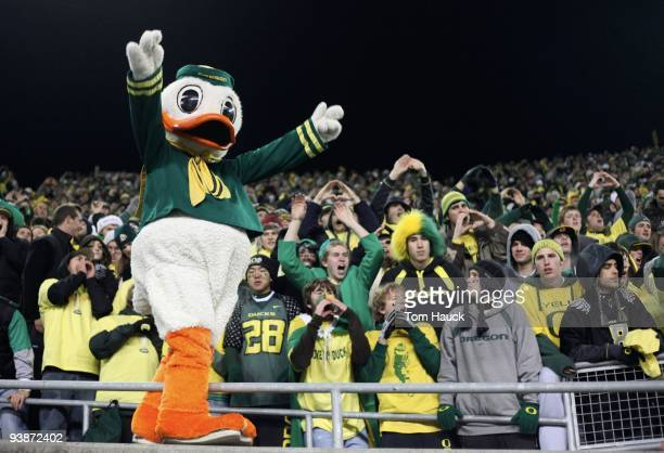 Oregon Ducks mascot Puddles cheers after his team's 3337 victory over the Oregon State Beavers after the game at Autzen Stadium on December 3 2009 in...