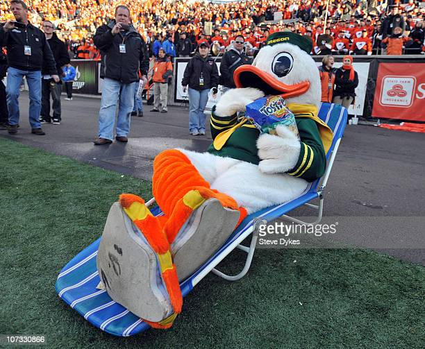 Oregon Ducks mascot 'Puddles' sits in a lawn chair and eats Tostitos chips as time winds down in the fourth quarter of the game against the Oregon...