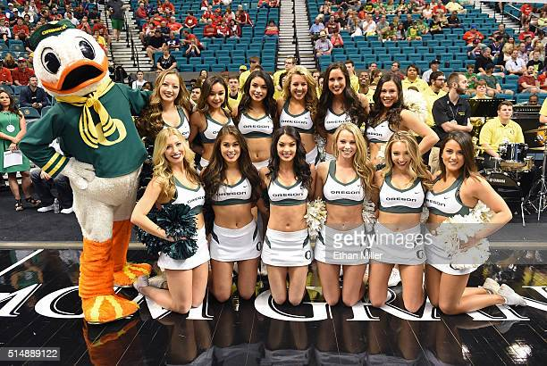 Oregon Ducks mascot The Duck poses with Oregon cheerleaders before the team's quarterfinal game of the Pac12 Basketball Tournament against the...