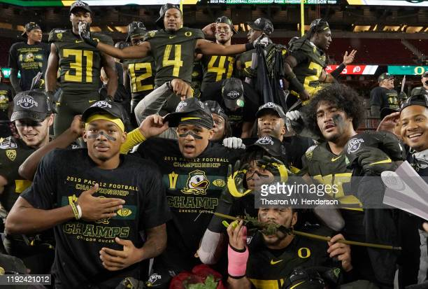 Oregon Ducks players celebrate after the Ducks defeated the Utah Utes 37-15 in the Pac-12 Championship Game at Levi's Stadium on December 06, 2019 in...