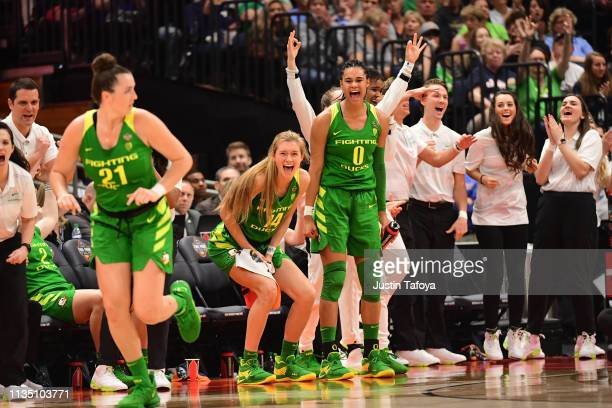 Oregon Ducks players celebrate against the Baylor Bears at Amalie Arena on April 5 2019 in Tampa Florida