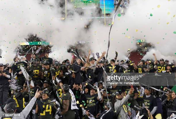 Oregon Ducks playerscelebrates after the Ducks defeated the Utah Utes 3715 in the Pac12 Championship Game at Levi's Stadium on December 06 2019 in...