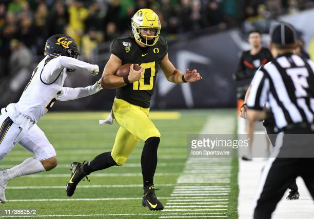 Oregon Ducks QB Justin Herbert runs with the ball during a college football game between the Cal Bears and Oregon Ducks at Autzen Stadium in Eugene,...