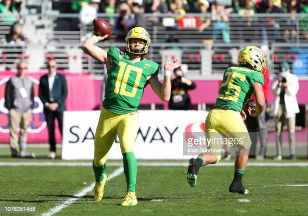 Oregon Ducks quarterback Justin Herbert goes to pass the ball in the first quarter during the Redbox Bowl game between the Michigan State Spartans...